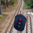 Railroad and semaphore with red signal - Stockfoto