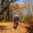 Girl walking in autumn park alley — Stock Photo #1593991