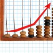 Increase diagram on old abacus - Stock Photo