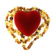 Box heart and amber necklace — Stock Photo