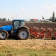 Tractor with plough - Stock Photo