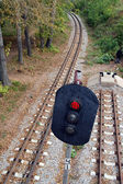 Railroad and semaphore with red signal — Stock Photo