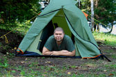 Big smiling man in camping tent — Stock Photo