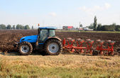 Tractor with plough — Stock Photo