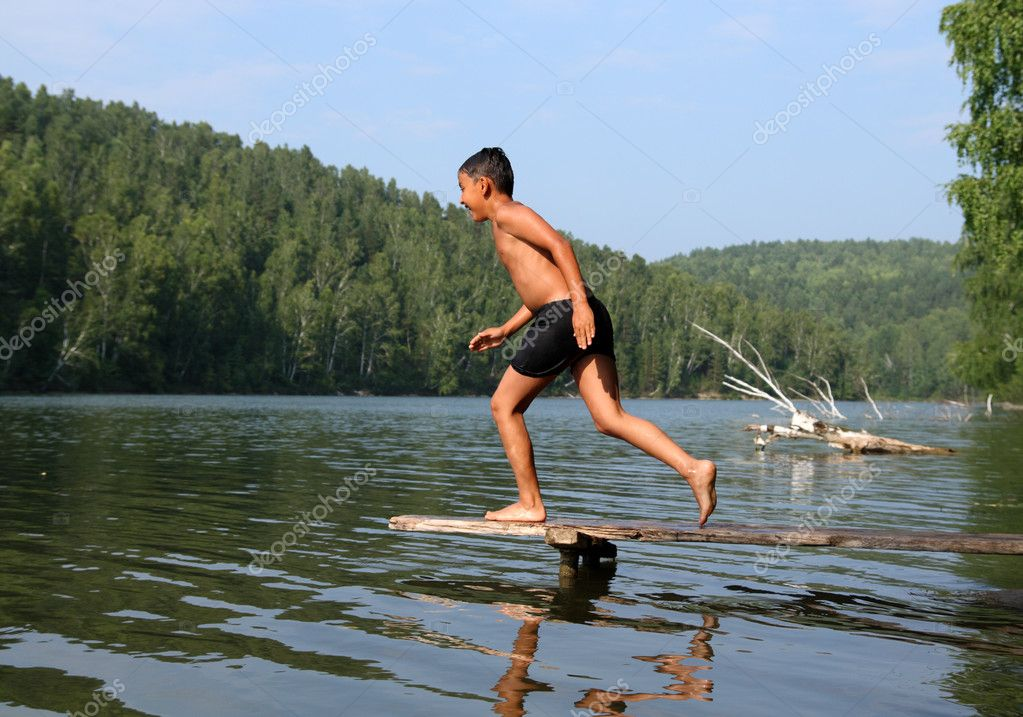 Happy asian boy diving in lake from stage  Stock Photo #1593825