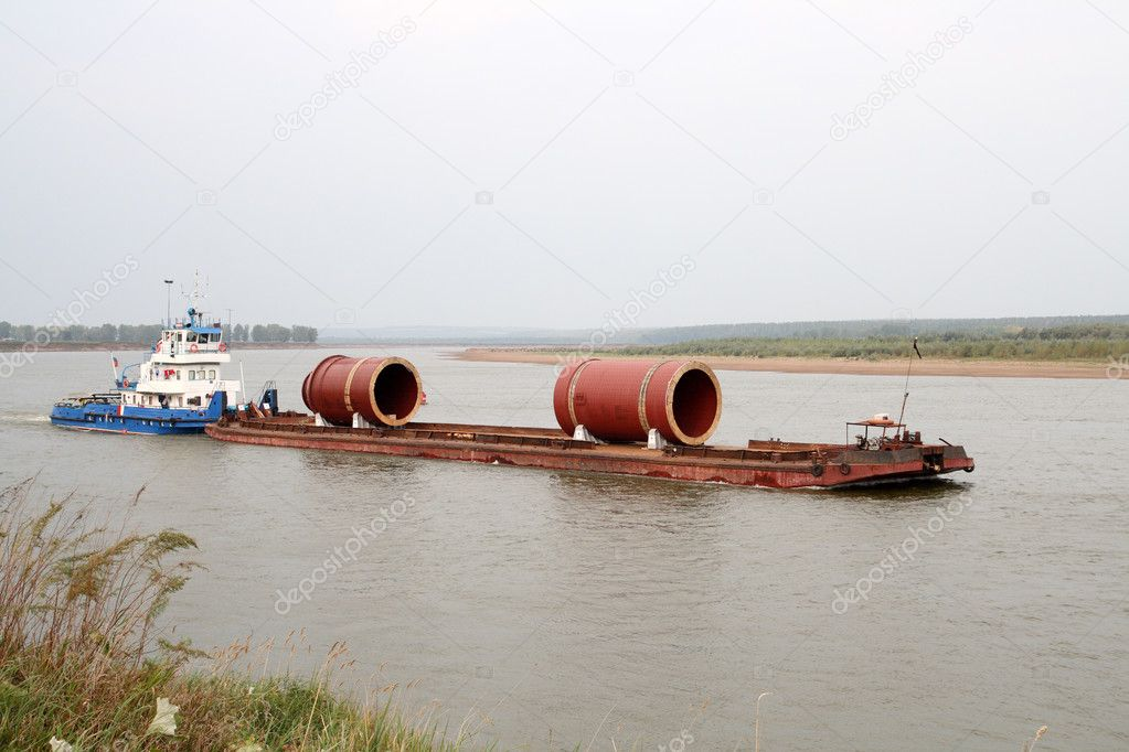 Industrial cargo transportation on river by ship with barge — Stock Photo #1595826