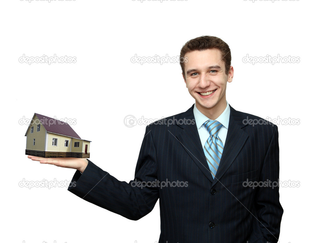 Businessman with house in hand isolated on white — Stock Photo #1643052
