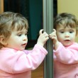 Baby with mirror — Stock Photo