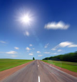 High speed road to sun — Stock Photo