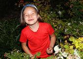 Fun girl eating raspberry — Stock Photo