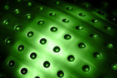 Spherical metal green surface background with ho — Stock Photo