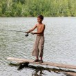 Boy fishing with spinning — Stock Photo