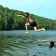 Boy jumping in lake — Stock Photo #2457936