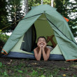Happy boy in camping tent — Stock Photo #2458044