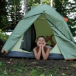 Happy boy in camping tent - Stock Photo