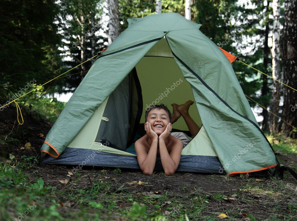 Happy boy in camping tent in summer forest  Stock Photo #2458044