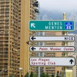 Direction signs on a post in Monte Carlo - Stock Photo