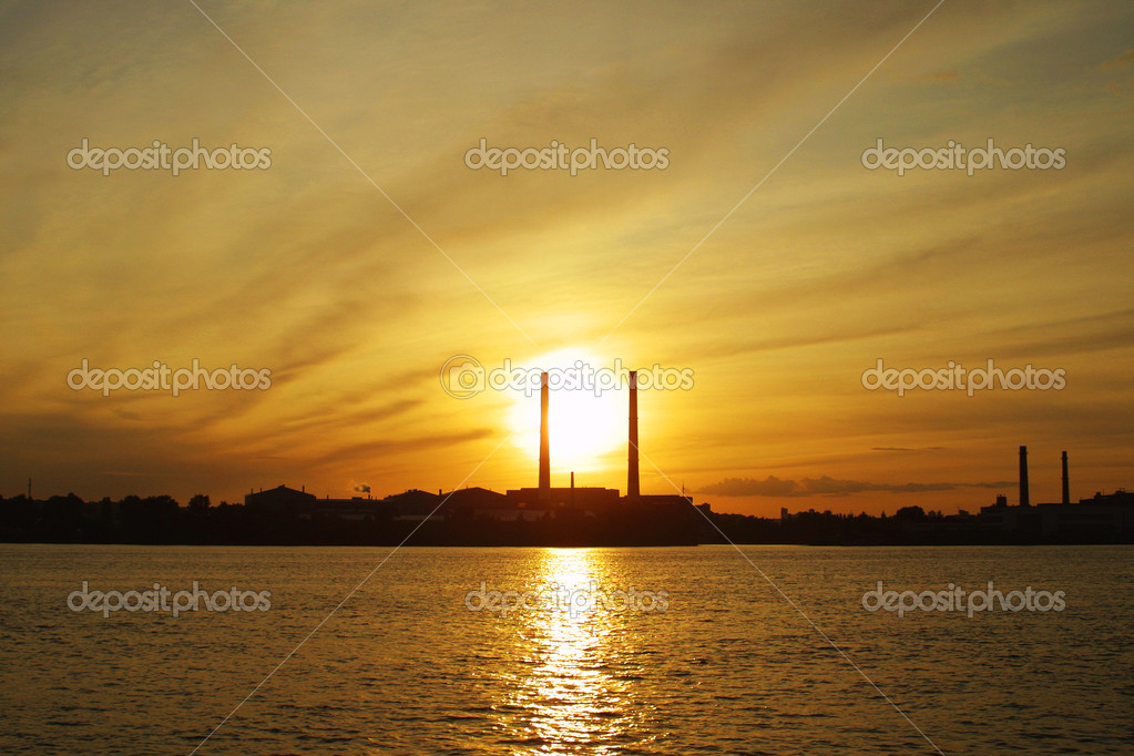 Sun settings behind power plant pipes — Stock Photo #1118894