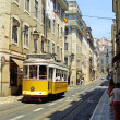 Typical yellow tram in Lisbon — Stock fotografie
