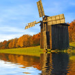 Windmill near the river — Stock Photo