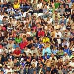 People seat on a stadium tribune — Stock Photo #1126917