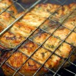 Salmon steak cooking on a grill - Stock Photo