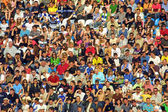 People seat on a stadium tribune — Stock Photo