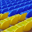 Royalty-Free Stock Photo: Blue and yellow empty stadium seats