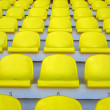 Stock Photo: Yellow empty stadium seats