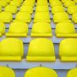 Yellow empty stadium seats — Stock Photo