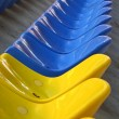 Blue and yellow empty stadium seats — Stock Photo #1138458
