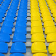 Blue and yellow empty stadium seats — Stock Photo #1138464