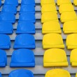 Blue and yellow empty stadium seats — Stock Photo #1138466