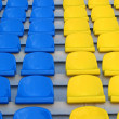 Blue and yellow empty stadium seats — Stock Photo