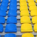 Blue and yellow empty stadium seats — Stock Photo