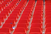 Red empty stadium seats — Stock fotografie