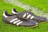 Football boots on a grass — Stock Photo