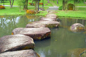 Stoneway and small lake in the garden — Stock Photo