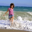 Walking girl on sandy beach — Stock Photo #1305379