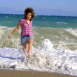 Walking girl on sandy beach - Stock Photo