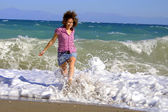 Walking girl on sandy beach — Stock Photo