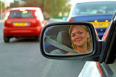 The face of a young woman driving a car — Stock Photo