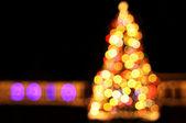 Bokeh lights of New Year tree — Stock Photo