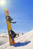 Snowboard on the mountain slop — Stock Photo