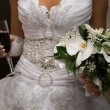 Bride hold bouquet and wine — Stock Photo #1096136
