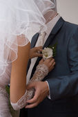 Bride attached the orchid to Groom — Foto Stock