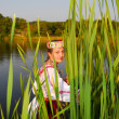 Girl in rushy lake - Stock Photo