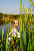 Girl in rushy lake — Stock Photo