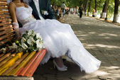 Bride and groom on the bench — Stock Photo