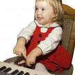 Stock Photo: Little girl play on piano
